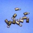 Bőrvég (430/B minta/10 db) - 10x5 mm, Gyöngy, ékszerkellék, Egyéb alkatrész, Ékszerkészítés, Szerelékek, Bőrvég (430/B minta) - bronz színben  Mérete: 10x5 mm (belül 3,5-4 mm) A furat mérete: 2 mm  Az ár ..., Alkotók boltja