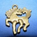 Medál (703. minta/1 db) - ló, Gyöngy, ékszerkellék,  Medál (703. minta) - ló - bronz színben  Mérete: 23x19x2 mm  Az ár egy darab termékre vonatko..., Alkotók boltja