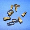 Medálvezető (356/B minta/1 db), Gyöngy, ékszerkellék, Ékszerkészítés,  Medálvezető (356/B minta) - antik bronz színben  Mérete: 11x4 mm (felül)  Az ár egy darab medálvez..., Alkotók boltja