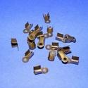 Bőrvég (430/A minta/1 db) - 9x4 mm, Gyöngy, ékszerkellék, Ékszerkészítés,  Bőrvég (430/A minta) -  antik bronz színben   Mérete: 9x4 mm Befogó rész: 4x4x3,5 mm A furat mér..., Alkotók boltja