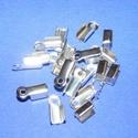Bőrvég (431/E minta/1 db) - 10x4 mm, Gyöngy, ékszerkellék, Ékszerkészítés,  Bőrvég (431/E minta) - ezüst színben  Mérete: 10x4 mm Befogó rész: 6x4x4 mm A furat mérete: 2 mm ..., Alkotók boltja
