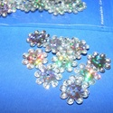 Flitter-38 (3 g) - hologramos ezüst (virág), Gyöngy, ékszerkellék, Varrás,  Flitter-38 - hologramos ezüst - virág  Mérete: Ø 12 mmA furat mérete: 1 mm  Kiszerelés..., Alkotók boltja