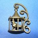 Medál (658/A minta/1 db) - kalitka, Gyöngy, ékszerkellék,  Medál (658/A minta) - kalitka - bronz színben  Mérete: 21x25x5 mm  Az ár egy darab termékre vo..., Alkotók boltja