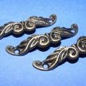 Fém fogantyú-5 (1 db) - antik bronz, Csat, karika, zár,  Fém fogantyú-5 - antik bronz  Mérete: 4,6x1 cmFurat: 3 mm  Az ár egy darab termékre vonatkozik..., Alkotók boltja
