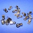 Bőrvég (5 minta/1 db) - 9x4 mm, Gyöngy, ékszerkellék, Ékszerkészítés,  Bőrvég (5 minta) - nikkel színben  Mérete: 9x4 mm Befogó rész: 4x4x3,5 mm A furat mérete: 2 mm  A..., Alkotók boltja