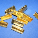 Szalagvég (19 minta/1 db) - 16x8x5 mm,  Szalagvég (19 minta) - arany színben  Mérete: ...