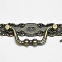 Fém fogantyú-18 (1 db) - antik bronz, Csat, karika, zár,  Fém fogantyú-18 - antik bronz  Mérete: 103x120 mm  Az ár egy darab termékre vonatkozik.  , Alkotók boltja