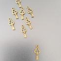 Kulcs medál, Dekorációs kellékek, Ékszerkészítés, Kulcs medál  Bronz színű, kulcs alakú medál.   Méret: 15 x 7 mm  Nyakláncok, fülbevalók gyönyörű al..., Alkotók boltja
