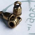 X50497 702, Gyöngy, ékszerkellék, Fém köztesek, Sárgaréz kupak ékszerkészítéshez. Bőrszál, pamutzsineg beragazstásával. Méret: 7 x 13 mm...., Alkotók boltja