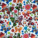 Szivárvány színű pillangó mintás pamut textil - AKCIÓ, Textil, Pamut, Varrás, Textil, Fehér alapon színes pillangók repkednek a virágok között. Az ár egy 45 X 60 cm-es pamut textil dara..., Alkotók boltja