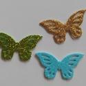 Glitteres dekorgumi pillangó dísz (15 db/cs), Dekorációs kellékek, Dekorgumi, Glitteres dekorgumi pillangó dísz Mérete: 3 cm x 5,3 cm vastagság: 0,2 cm  A csomagban 15 db dísz v..., Alkotók boltja
